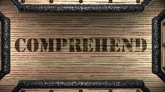 Comprehend on wooden stamp Stock Footage