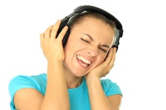 Young attractive woman with headphones listen to the music, isolated on white Stock Footage