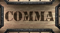 comma on wooden stamp - stock footage