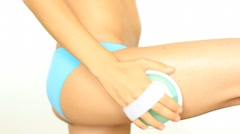 Woman doing anti-cellulite massage to her thigh, isolated on white HD Stock Footage