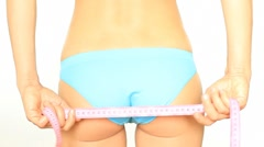 Woman measuring buttocks with measuring tape, isolated on white HD Stock Footage