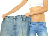 Slim woman showing her old big jeans, isolated on white NTSC Stock Footage