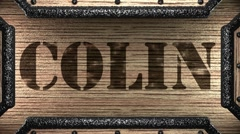 colin on wooden stamp - stock footage