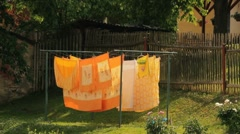 Washed clothes drying outside of an old house Stock Footage