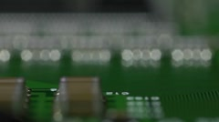 Low level reverse pass over a circuit board, shallow depth of field. Stock Footage