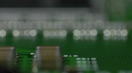 Stock Video Footage of low level reverse pass over a circuit board, shallow depth of field.