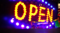 Glowing open neon display sign in a window Stock Footage