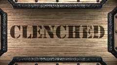 clenched on wooden stamp - stock footage