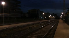 Night freight train aproaches and passes by. Stock Footage