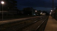 Stock Video Footage of Night freight train aproaches and passes by.