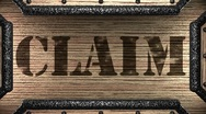 Stock Video Footage of claim on wooden stamp