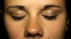 Close up of young womans face and eyes, very shallow depth of field - stock footage