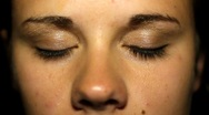 Close up of young woman opening eyes Stock Footage