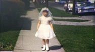 Stock Video Footage of Little Girl in Confirmation Dress Circa 1960 (Vintage Film Home Movie) 536