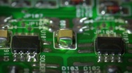 Stock Video Footage of extreme close up of a green printed circuit board, Fly past. 2