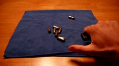 Stock Video Footage of Unloading a pistol magazine