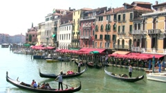 Gondoliers rowing gondolas on the Grand Canal Venice Italy Stock Footage