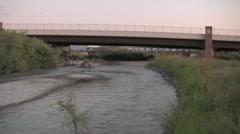 Beautiful river flow under a bridge Stock Footage