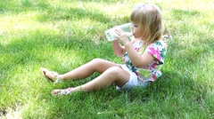 Little girl drinking milk Stock Footage