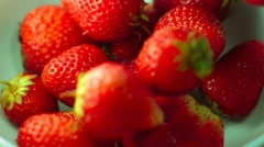Strawberry  falls in a  white bowl, slow motion Stock Footage