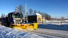 Scandinavia Finland Pori Charlotta bridge snow truck cleaning snow away Stock Footage