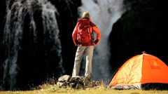 Female Hiker by Tent at Waterfall Stock Footage