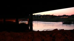 River flow under a bridge with reflection of house Stock Footage