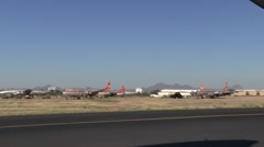 Pan of parked planes from ultralight moving down runway  (HD) c Stock Footage