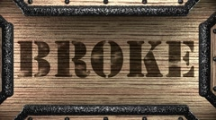 Broke on wooden stamp Stock Footage