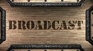Broadcast on wooden stamp Stock Footage