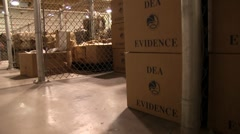 Stock Video Footage of drug bust evidence in DEA warehouse (HD) c