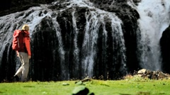 Female Hiker Stopping at Waterfall Stock Footage