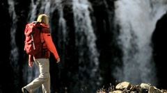 Female Hiker Resting at a Waterfall - stock footage