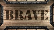 Stock Video Footage of brave on wooden stamp