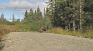 Stock Video Footage of Reckless Pickup Truck Spins Out On Gravel road