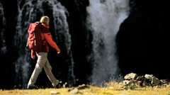 Lone Female on Hiking Expedition by Waterfall Stock Footage