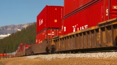 Railroad, container train, long lens into bend, medium shot Stock Footage