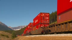 Railroad, container rain, long lens into bend wide shot Stock Footage