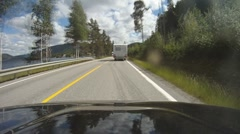 BMW passing a camper on a country road Stock Footage