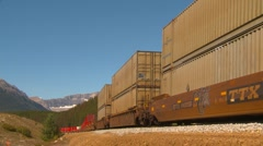Railroad, container rain, long lens into bend wide end of train Stock Footage