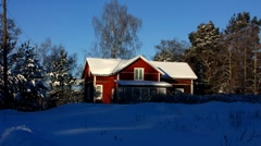 Scandinavia Finland red wooden cottage in winter snow Stock Footage
