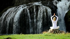 Yoga Exercises at Flowing Waterfall Stock Footage