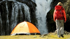 Hiker & Her Tent by Cascading Waterfall Stock Footage