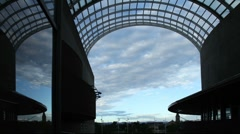 Morning clouds through Glass Archway Timelapse Stock Footage