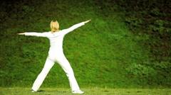 Female Yoga Exercises Outdoors - stock footage