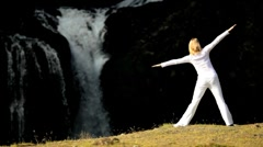 Girl Practising Yoga by Waterfall Stock Footage