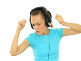 Stock Video Footage of Young attractive woman with headphones dancing, isolated on white