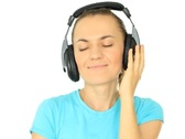 Stock Video Footage of Young attractive woman with headphones listen to the music, isolated on white
