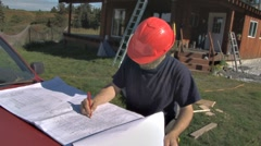 Contractor Checking Construction Plans 2 Stock Footage