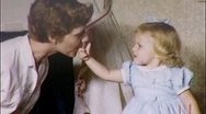 Give Mommy a Taste! GIRL MOTHER BIRTHDAY CAKE 1950s Vintage Film Home Movie 580 Stock Footage